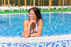 Beautiful Sexy Woman Relaxing In Swimming Pool Water. Girl With Healthy Tanned Skin, Gorgeous Face, And Wet Hair Enjoying Summer S Royalty Free Stock Images