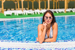 Beautiful Sexy Woman Relaxing In Swimming Pool Water. Girl With Healthy Tanned Skin, Gorgeous Face, And Wet Hair Enjoying Summer S. Un On Hot Summer Day At Pool Royalty Free Stock Images