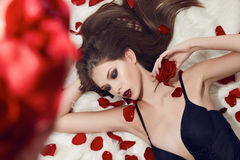 Beautiful sexy woman rose makeup underwear brunette flower Royalty Free Stock Image