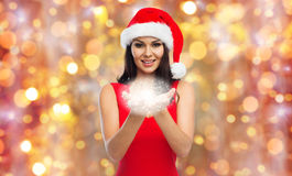 Beautiful sexy woman in santa hat with fairy dust Stock Photography