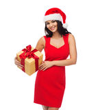 Beautiful sexy woman in santa hat with gift box Stock Photo