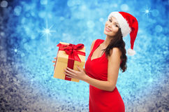 Beautiful sexy woman in santa hat with gift box Stock Images