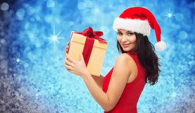Beautiful sexy woman in santa hat with gift box Stock Photos