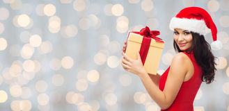 Beautiful sexy woman in santa hat with gift box Royalty Free Stock Photography