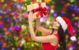 Beautiful sexy woman in santa hat with gift box Royalty Free Stock Photo