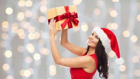 Beautiful sexy woman in santa hat with gift box Royalty Free Stock Image