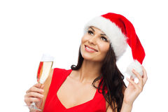 Beautiful sexy woman in santa hat and red dress. People, holidays, christmas and celebration concept - beautiful sexy woman in santa hat and red dress with Stock Photos