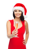 Beautiful sexy woman in santa hat and red dress Stock Photos