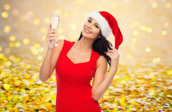 Beautiful sexy woman in santa hat and red dress Stock Images