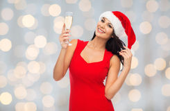 Beautiful sexy woman in santa hat and red dress Royalty Free Stock Images