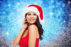 Beautiful sexy woman in santa hat and red dress Royalty Free Stock Photos