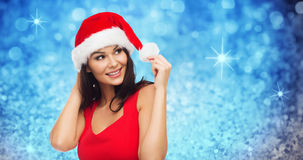 Beautiful sexy woman in santa hat and red dress Stock Image