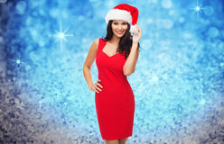 Beautiful sexy woman in santa hat and red dress Stock Photography