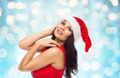 Beautiful sexy woman in santa hat and red dress Royalty Free Stock Image