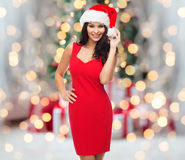 Beautiful sexy woman in santa hat and red dress Royalty Free Stock Photography