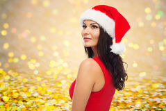 Beautiful sexy woman in santa hat and red dress Stock Photo