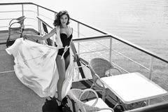 Beautiful sexy woman silk dress brunette sea water restaurant Stock Images