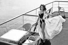 Beautiful sexy woman silk dress brunette sea water restaurant Stock Photo