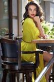 Beautiful woman silk dress makeup cafe summer Stock Images
