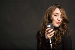 Beautiful sexy woman singing Stock Photography