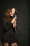 Beautiful sexy woman singing Stock Images