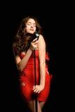 Beautiful sexy woman singing Stock Photo