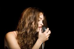 Beautiful sexy woman singing Royalty Free Stock Photos