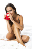 Sexy woman drinking coffee Stock Image