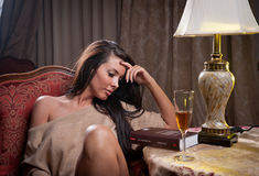 Beautiful sexy woman sitting on chair and relaxing Royalty Free Stock Photos
