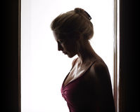 Beautiful, woman stands in doorway Royalty Free Stock Image