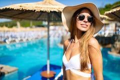 Beautiful woman in bikini on beach during vacation stock image