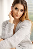 Beautiful and sexy woman in sweater Royalty Free Stock Photography