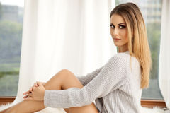 Beautiful and sexy woman in sweater Royalty Free Stock Photo