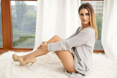 Beautiful and sexy woman in sweater Stock Photos