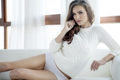 Beautiful and sexy woman in sweater Royalty Free Stock Images
