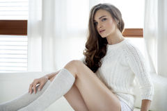 Beautiful and sexy woman in sweater Royalty Free Stock Image