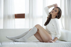 Beautiful and sexy woman in sweater Stock Photography