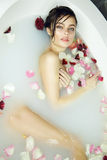 Beautiful sexy woman takes bath rose candles Valentine's day spa Stock Images