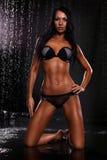 Beautiful sexy woman in water studio Stock Photo