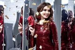 Beautiful sexy woman wear lux skinny shine red dress shiny sequi. Ns style for party celebrate New Year Christmas beauty salon hair style makeup perfect body Stock Images