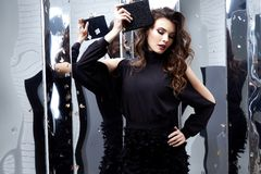 Beautiful sexy woman wear luxury black dress shine sequins style. For party celebration New Year Christmas birthday girl beauty salon hair style makeup perfect Stock Image