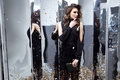 Beautiful sexy woman wear luxury black dress shine sequins style. For party celebration New Year Christmas birthday girl beauty salon hair style makeup perfect Stock Photography