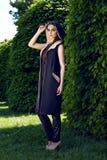 Beautiful sexy woman wearing dress walk park sun shine makeup Royalty Free Stock Images