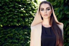 Beautiful sexy woman wearing dress walk park sun shine makeup Stock Photos
