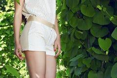 Beautiful sexy woman wearing dress walk park sun shine makeup Royalty Free Stock Photography