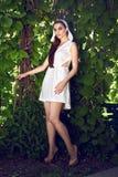 Beautiful sexy woman wearing dress walk park sun shine makeup Royalty Free Stock Photos