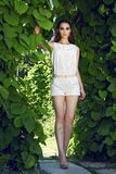 Beautiful sexy woman wearing dress walk park sun shine makeup Royalty Free Stock Photo