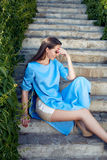 Beautiful sexy woman wearing dress walk park sun shine makeup Stock Image