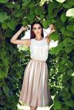 Beautiful sexy woman wearing dress walk park sun shine makeup Royalty Free Stock Image