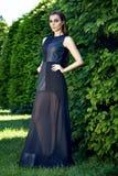 Beautiful sexy woman wearing dress walk in the park sun shine Royalty Free Stock Photo